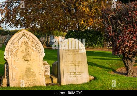 Haddington, East Lothian, Scotland, United Kingdom, 6th November 2018.. UK Weather: Sunshine at St Marys' Parish Church graveyard - Stock Photo