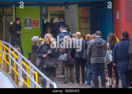 New York, USA. 6th November, 2018. Voters enter and leave the PS33 polling station in the Chelsea neighborhood of New York on Election Day, Tuesday, November 6, 2018. Credit: Richard Levine/Alamy Live News - Stock Photo