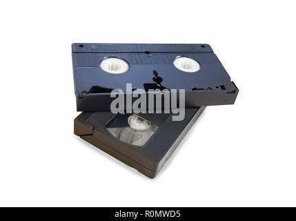 Two old black VHS tapes isolated over white - Stock Photo