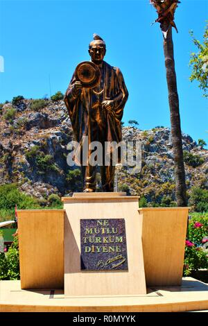 Dalyan, Turkey - July 7th 2018: Statue in Dalyan town of Mustafa Kemal Ataturk, the first President  and founder of the Republic of Turkey. - Stock Photo