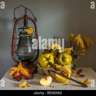 still life with quince and kerosene lamp. kitchen. vintage retro. - Stock Photo