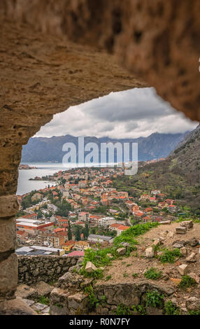 View of the Kotor Bay and Old Town housesfrom the small chapel on the hillside above, Montenegro - Stock Photo