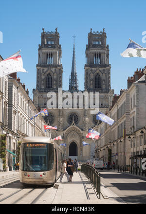 People at tram stop on Rue Jeanne d'Arc in Orléans, Centre-Val de Loire, France, Europe - Stock Photo