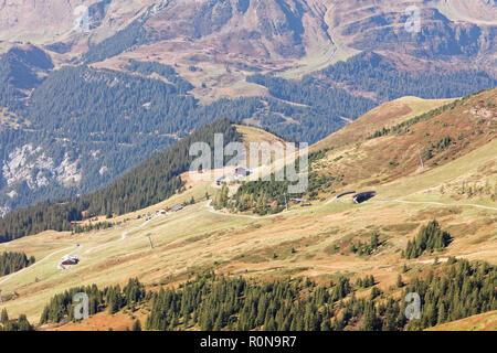 Train descending from Kleine Scheidegg towards Wengernalp station; view from Fallbodensee (Fallboden lake) at Fallboden, Jungfrau Region, Switzerland - Stock Photo
