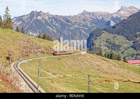 Panoramatic view of Jungfrau Region with incoming train from Gruetschalp (Grütschalp) near Winteregg, Jungfrau Region, Switzerland - Stock Photo