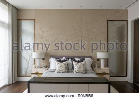 Double bed in oriental bedroom - Stock Photo