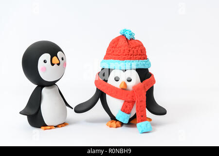 cute sugar owl and penguin cartoon character wrapped up for Christmas winter - Stock Photo