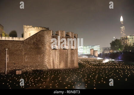 London, UK – October 5 2018: Lights fill the moat of the Tower of London as part of an art installation Beyond the Deepening Shadow, to mark the cente - Stock Photo