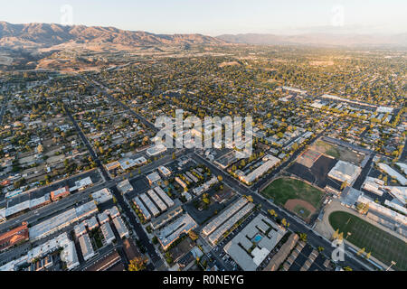 Late afternoon aerial towards Devonshire St and De Soto Ave in the Chatsworth neighborhood in the San Fernando Valley area of Los Angeles, California. - Stock Photo