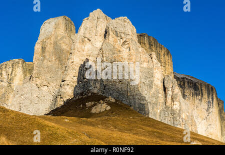 autumn view of the mountain from the Sella Pass. Its connects the Gardena Valley in South Tyrol and Canazei in the Fassa Valley in Trentino, Italy. - Stock Photo