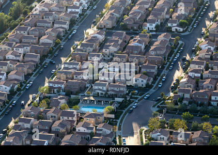 Late afternoon aerial view of tightly packed modern homes in the Porter Ranch area of Los Angeles, California. - Stock Photo