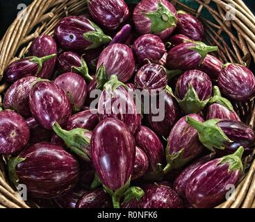 Eggplants in a basket at the Farmers Market - Stock Photo