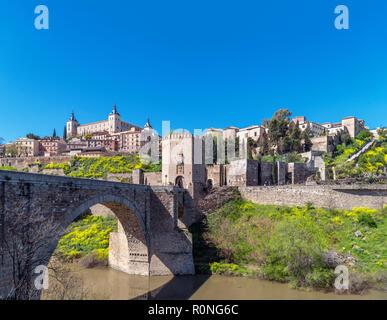Toledo, Spain. The historic old town, Alcazar, River Tagus and Puente de Alcantara, Toledo, Castilla-La Mancha, Spain - Stock Photo