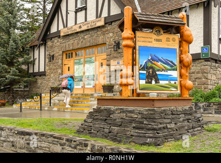 BANFF, AB, CANADA - JUNE 2018: Large sign with wood carvings for Banff National Park outside the Tourist Information Centre in  Banff town centre. - Stock Photo