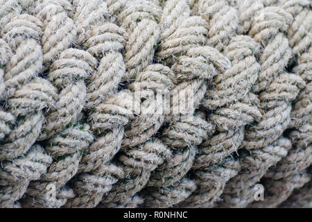 Old brown weathered rope texture. Details closeup. - Stock Photo