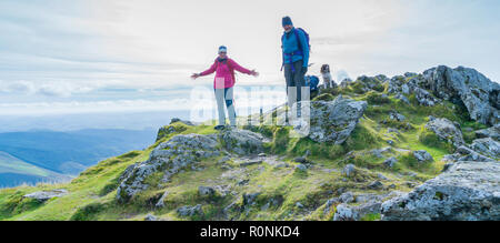 Two people standing on the summit of Cadair Idris in Snowdonia National Park, Wales, UK - Stock Photo
