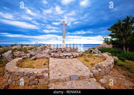 Island of Krk cross by the sea in Stara Baska village, northern Adriatic region of Croatia - Stock Photo