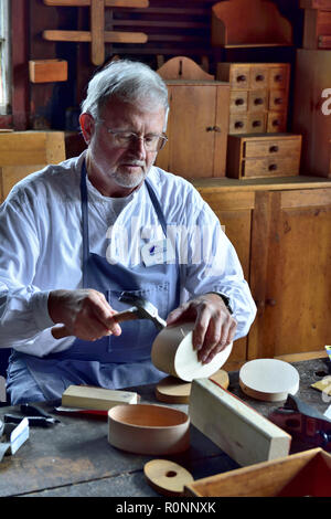 Inside Hancock Shaker Village woodworking workshop with man making a traditional oval Shaker wooden box Pittsfield MA, USA - Stock Photo
