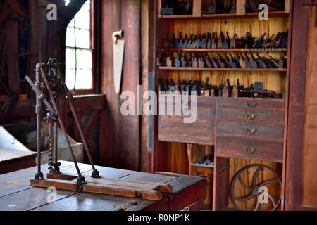 Inside Hancock Shaker Village woodworking workshop with barn beam drill press and molding planes Pittsfield MA, USA - Stock Photo