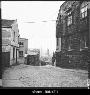 Sandygate, Burnley, Lancashire, c1966-c1974. A view along Sandygate towards the town centre with the former Neptune Inn in the left foreground and Clock Tower Mill in the right foreground. - Stock Photo