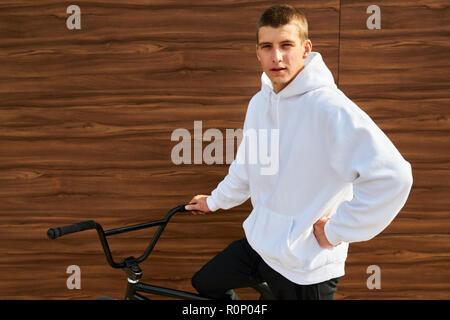 Young Man Wearing Hoodie - Stock Photo