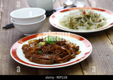 fenpi, green bean sheet jelly noodles with pickled cabbage and minced pork meat, chinese home cooking - Stock Photo