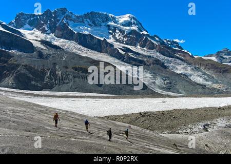 Glacier trekking on the Gorner Glacier,  peak Breithorn and the glaciers Breithorngletscher and Schwärzegletscher behind, Zermatt, Valais, Switzerland - Stock Photo