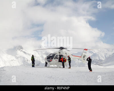 Rescue operation with helicopter on a ski slope in the ski resort of Tignes, the Alps, France - Stock Photo