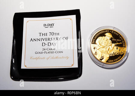 Specially minted coin. 70th anniversary D-Day 24 carat gold plated one crown coin. Commemoration coin. Second World War remembered. White background - Stock Photo