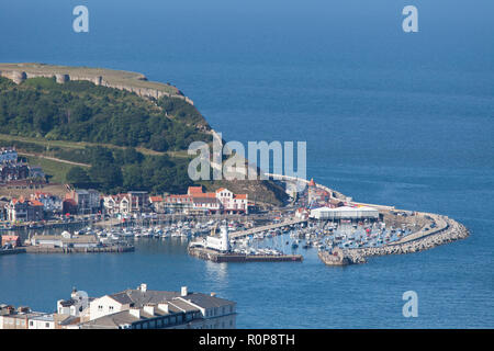 View of the South Bay, town, castle and harbour at Scarborough in North Yorkshire taken from Oliver's Mount, a hill overlooking the town - Stock Photo