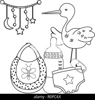 stork toys and baby clothing in black and white - Stock Photo