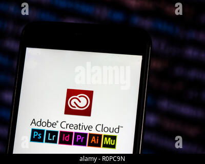 Adobe Creative Cloud logo seen displayed on smart phone. Adobe Creative Cloud is a set of applications and services from Adobe Systems that gives subscribers access to a collection of software used for graphic design, video editing, web development, photography, along with a set of mobile applications and also some optional cloud services. - Stock Photo