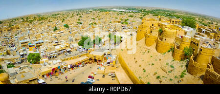 Aerial fish-eye panoramic view from Royal Palace top over entrance, Jaisalmer rooftops and surrounding desert, Rajasthan, India - Stock Photo