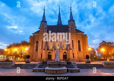 Christian reformed church illuminated at blue hour, in Maramures region, Sighetu Marmatiei - Stock Photo