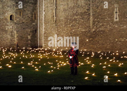 London, UK. 6th November, 2018. Evocative scenes at the Tower of London for the Remembrance commemoration - The Tower Remembers - Beyond the Deepening Shadow. The flames will be lit by volunteers every night until November 11th Credit: Monica Wells/Alamy Live News - Stock Photo