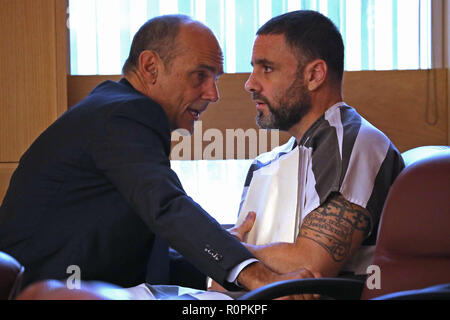 Fort Lauderdale, FL, USA. 28th Aug, 2017. Attorney Benjamin Waxman speaks with his client Pablo Ibar during a status hearing in Broward court. Ibar was sentenced to death in 2000 for the home-invasion murders of Casimir ''Butch Casey'' Sucharski, Sharon Anderson and Marie Rogers. The Florida Supreme Court threw out the conviction in 2016 and now Ibar will get a third chance early next year to convince a jury he's not guilty in the notorious execution-style slayings of a Broward County nightclub manager and his two friends 23 years ago Credit: Sun-Sentinel/ZUMA Wire/Alamy Live News - Stock Photo