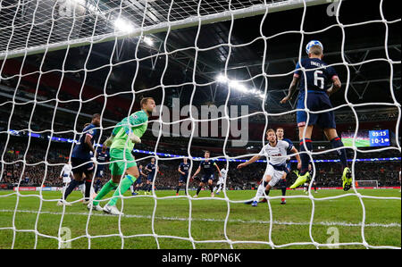 London, UK. 6th Nov, 2018. Eindhoven's Angelino (1st R) heads for the ball during the UEFA Champions League match between Tottenham Hotspur and PSV Eindhoven in London, Britain on Nov. 6, 2018. Tottenham Hotspur won 2-1. Credit: Han Yan/Xinhua/Alamy Live News - Stock Photo