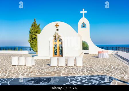 Wedding chapel with sea view on the hill near Faliraki (Rhodes, Greece) - Stock Photo
