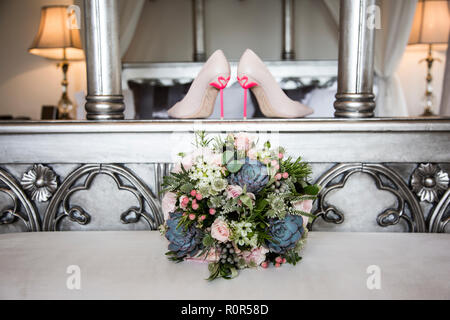 wedding day brides shoes with flamingo heels on them - Stock Photo