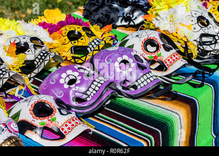Day of the Dead, Dia de los Muertos, colorful skull masks for sale during celebration in New Mexico USA.