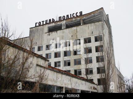 Hotel Polissya in ghost town Pripyat in in Chernobyl Exclusion Zone, Ukraine. - Stock Photo