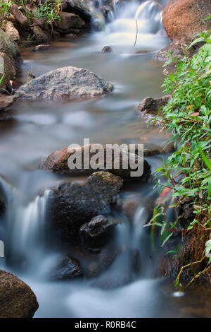 A long exposure of a water stream showing its trails like a fairy tale - Stock Photo