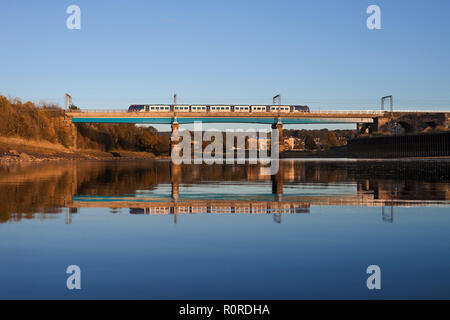 A brand new CAF class 195 DMU train for Arriva Northern rail on a test run crossing the river lune viaduct on the west coast main line at Lancaster - Stock Photo