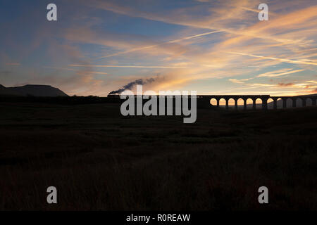 West Coast Railways steam locomotive 35018 British India Lines crossing Ribblehead viaduct on the Settle to Carlisle railway with a charter train