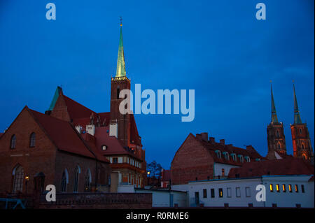 Blue hour, Ostrow Tumski (Cathedral Island), Wroclaw, Poland. Church spires and rooftops silhouetted against deep blue night sky. - Stock Photo
