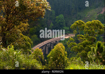 Aerial view to the Nine Arches Bridge or 'Bridge in the Sky', Ella, Sri Lanka. Iconic landmark built in 1921, of rocks, bricks and cement. - Stock Photo