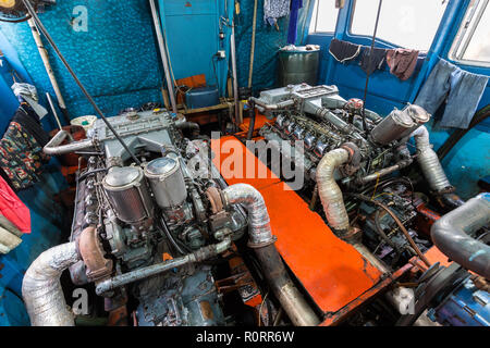 Big boat engine inside a tourist passenger boat in Thailand - Stock Photo