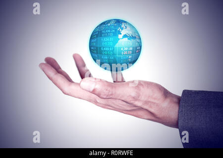 Businessman holding global business world in his hand. Global business and technology concept. - Stock Photo