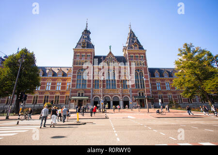 AMSTERDAM, NETHERLANDS - SEPTEMBER 2, 2018: Exterior for of the historic Rijksmuseum with people in view - Stock Photo