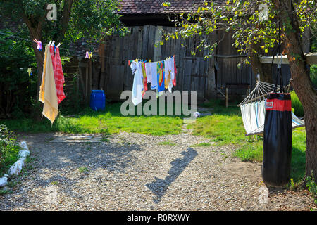 Some colorful towels drying on a line at a traditional farmhouse-restaurant in Viscri (Transylvania), Romania - Stock Photo